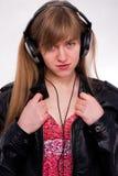 Bella ragazza con le cuffie Fotografia Stock Libera da Diritti