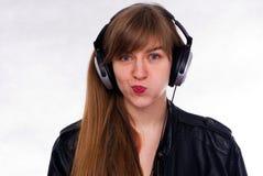 Bella ragazza con le cuffie Fotografie Stock