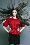 Bella ragazza con pelle perfetta e capelli lunghi fotografia stock