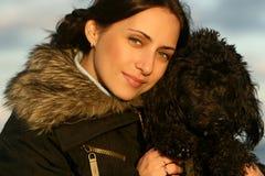 Bella ragazza con un cane Fotografie Stock