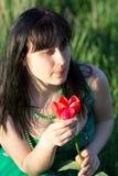 Bella ragazza con un fiore immagini stock libere da diritti