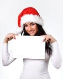 Bella ragazza con un foglio di carta pulito Fotografie Stock