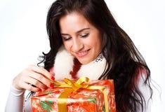 Bella ragazza con un regalo Immagine Stock