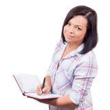 Bella ragazza del ollege del ¡ dei giovani Ð con una penna e un manuale Fotografie Stock