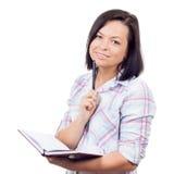 Bella ragazza del ollege del ¡ dei giovani Ð con una penna e un manuale Fotografia Stock