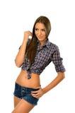 Bella ragazza del paese che posa con la mano sull'anca Fotografia Stock