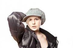 bella ragazza del whitehair con il kepi Fotografia Stock