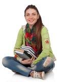Bella ragazza dello studente che si siede con i libri Fotografia Stock