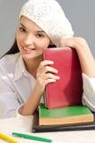 Bella ragazza dello studente con i libri. Fotografie Stock