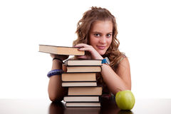 Bella ragazza felice, con una pila di libri Immagini Stock Libere da Diritti
