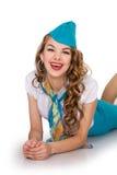 Bella ragazza i sorrisi di menzogne dell'hostess Fotografia Stock
