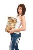 Bella ragazza che tiene una pila di libri Immagine Stock Libera da Diritti