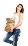 Bella ragazza che tiene una pila di libri Immagini Stock Libere da Diritti
