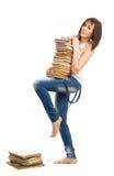 Bella ragazza che tiene una pila di libri Fotografia Stock Libera da Diritti