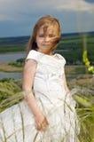 Bella ragazza nei vestiti della sposa Fotografie Stock