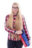 Bella ragazza in occhiali con capelli ed i libri lunghi nel suo Han Immagini Stock Libere da Diritti