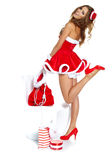 Bella ragazza sexy che porta i vestiti del Babbo Natale Immagine Stock Libera da Diritti