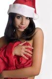 Bella ragazza sexy che porta il cappello del Babbo Natale fotografia stock