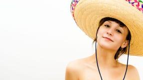 Bella ragazza sorridente in un cappello di paglia Fotografie Stock