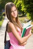 Bella ragazza teenager amichevole dell'allievo. Immagini Stock