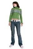 Bella ragazza teenager che si leva in piedi contro la priorità bassa bianca Fotografie Stock Libere da Diritti