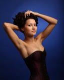 Bella ragazza in un corsetto Fotografie Stock
