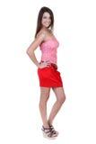 Bella ragazza in un mini pannello esterno rosso fotografia stock