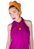 Bella ragazza in un vestito da colore Fotografia Stock