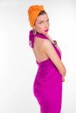 Bella ragazza in un vestito da colore Fotografie Stock Libere da Diritti