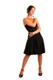 Bella ragazza in un vestito nero Fotografie Stock Libere da Diritti