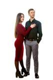 Bella ragazza in un vestito rosso ed in un uomo Fotografia Stock