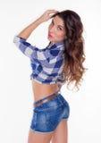 Bella ragazza in una camicia e negli shorts Fotografia Stock Libera da Diritti