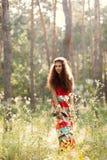 Bella ragazza in una foresta Immagine Stock