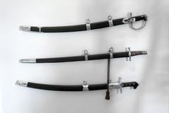 Bella sciabola della spada con le guaine con una struttura sotto il metallo fotografia stock