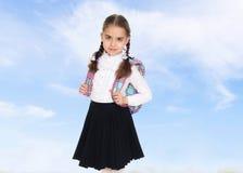 Bella scolara con uno zaino dietro le sue spalle Immagine Stock Libera da Diritti