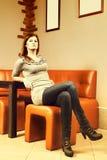 Bella seduta della ragazza immagini stock