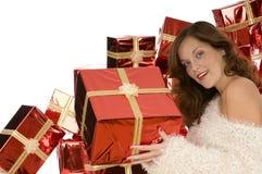 Bella signora che dà un presente Immagini Stock