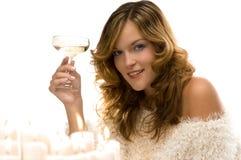 Bella signora che tosta con il champagne Immagini Stock