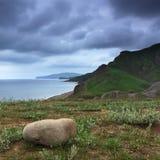 Bella spiaggia con il cielo drammatico Fotografia Stock