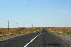 Bella strada del deserto Immagini Stock Libere da Diritti