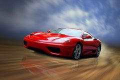 Bella velocità rossa sportcar sulla strada Immagine Stock Libera da Diritti
