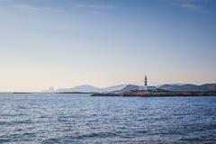 Bella vista della siluetta del faro di Ibiza fotografia stock libera da diritti