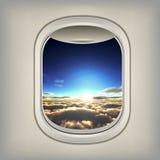 Bella vista nell'oblò dell'aereo Fotografia Stock