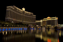 Bellagio and Caesars Palace casino and hotel in Las Vegas, Nevada. Buildings at the Bellagio and Caesars Palace casino and hotel reflecting in the fountain lake Stock Photo