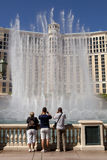 The Bellagio Casino and Hotel in Las Vegas, Nevada. Tourist sightseeing at The Bellagio Casino and Hotel in Las Vegas, Nevada. The lake infront of the hotel has Royalty Free Stock Photo