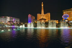 Bellagio Casino Water Show at night with Paris Casino and Eiffel Tower, Las Vegas, NV Stock Images