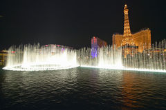 Bellagio Casino Water Show at night with Paris Casino and Eiffel Tower, Las Vegas, NV Stock Photography