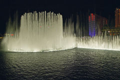 Bellagio Casino Water Show at night with Paris Casino and Eiffel Tower, Las Vegas, NV Stock Photos