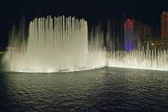 Bellagio Casino Water Show at night with Paris Casino and Eiffel Tower, Las Vegas, NV Stock Photos