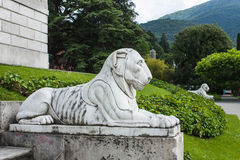 Bellagio city on Lake Como, Italy. Lombardy region. Italian famous landmark, Villa Melzi Park. sculpture of lieing lion Royalty Free Stock Photography